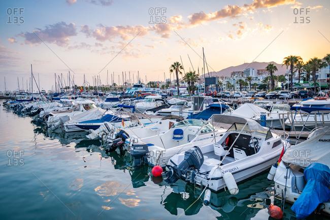 August 19, 2018: Boats at sunset at Benalmadena Puerto Marina between the Costa Del Sol beach resorts of Benalmadena and Torremolinos, Andalusia, Spain, Europe