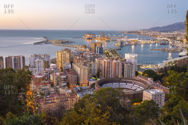January 28, 2019: View from the view point of Gibralfaro by the castle with the La Malagueta bullring and the harbor at sunrise, Malaga, Andalusia, Spain, Europe