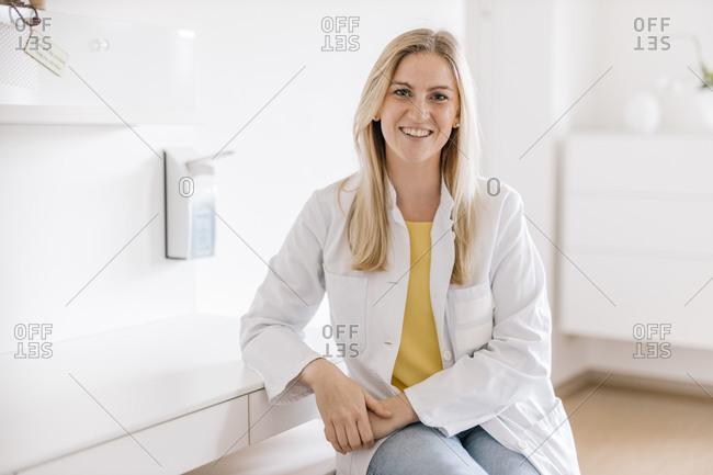 Portrait of smiling female doctor in medical practice