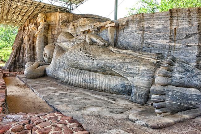 Sri Lanka- North Central Province- Polonnaruwa- Sculpture of lying Buddha in Gal Vihara temple
