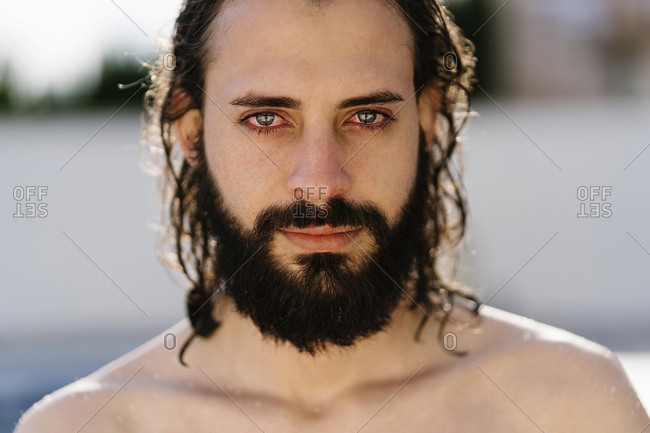 Portrait of a man with beard and wet hair