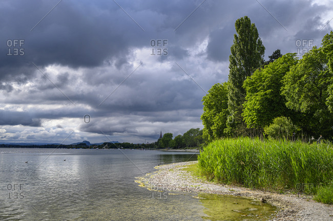 Germany- Baden-Wurttemberg- Radolfzell- Storm clouds over shore of Lake Constance