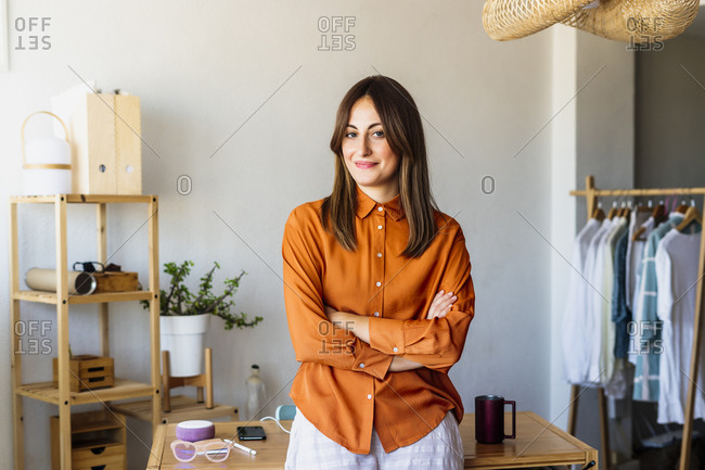 Portrait of a confident female fashion designer in home office