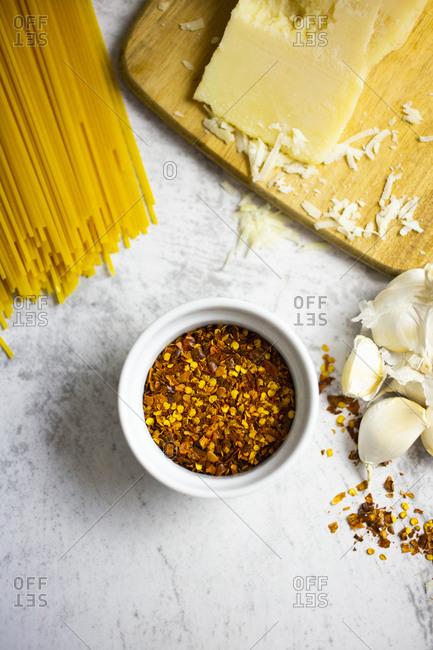 Chilli seeds- grana cheese- garlic and spaghetti
