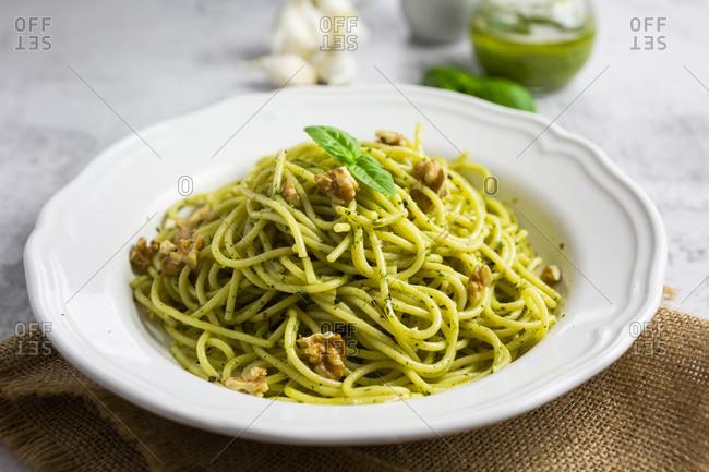 Spaghetti with pesto- walnut- basil andchilliandgranacheese
