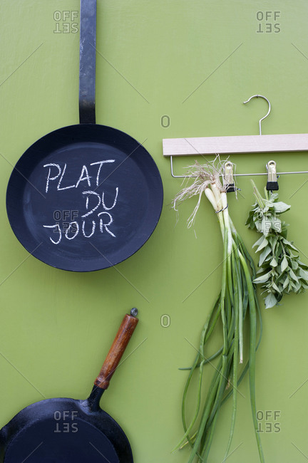 Frying pans andcoat hanger with herbs