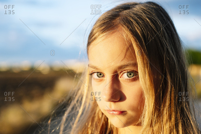 Blond girl staring with sunlight on her face