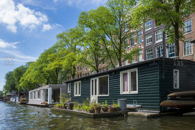 The Netherlands- North Holland Province- Amsterdam-Houseboat with small garden on Prinsengracht canal