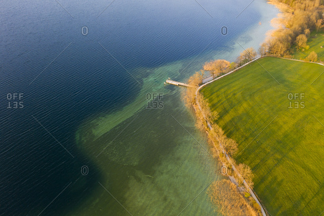 Germany- Bavaria- Gmund am Tegernsee- Drone view of treelined shore of Tegernsee