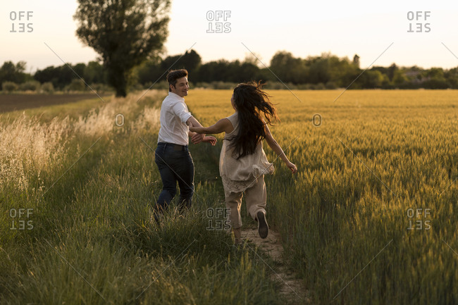 Dancing couple on field in the evening
