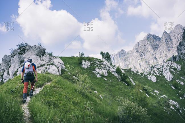 Hiker walking on mountain path- Orobie- European Alps- Como- Italy