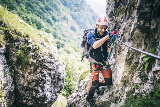 Mountaineer climbing on via ferrata- Orobie- European Alps- Como- Italy