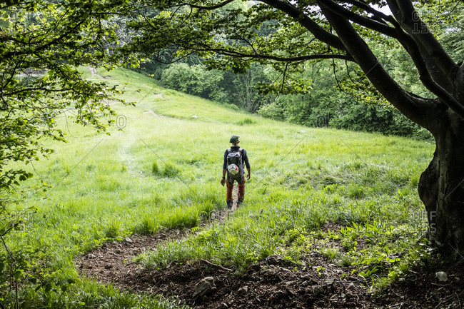 Hiker walking on mountain meadow- Orobie- European Alps- Como- Italy