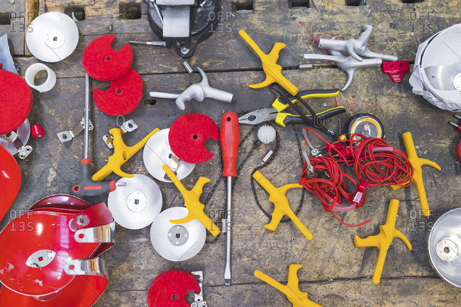 Overhead view of tools and fencing supplies on workbench