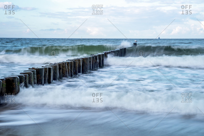 Waves smashing against coastal groyne at the Baltic Sea- Germany