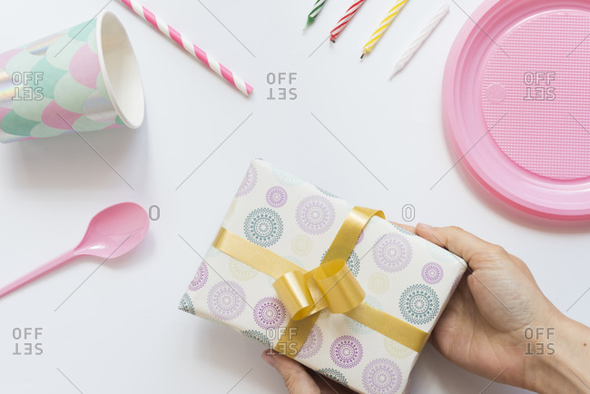 Hands of woman holding wrapped birthday present