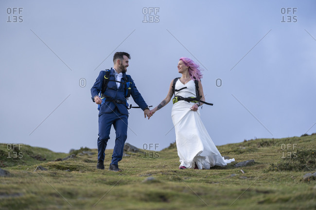 Bridal couple with climbing backpacks at Urkiola mountain- Spain