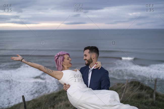 Bridal couple on viewpoint and ocean in the background