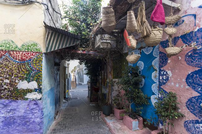 Morocco- Tanger-Tetouan-Al Hoceima- Tangier- Stores along narrow alley in historic medina