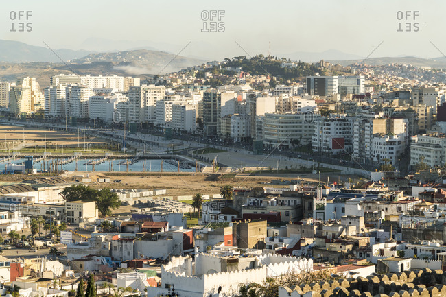 Morocco- Tanger-Tetouan-Al Hoceima- Tangier- Harbor and residential buildings of coastal city