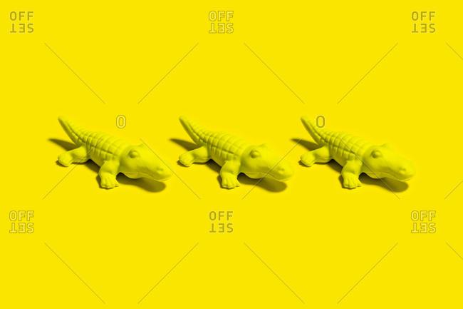 Studio shot of three small crocodile figurines