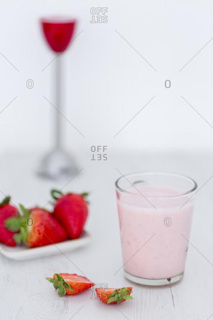 Glass of strawberry milkshake dessert