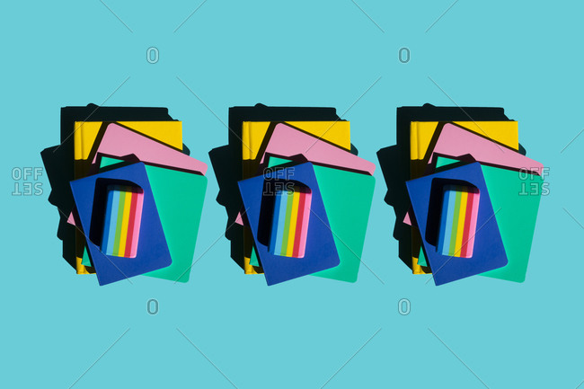 Row of stacks of notebooks and rainbow colored erasers