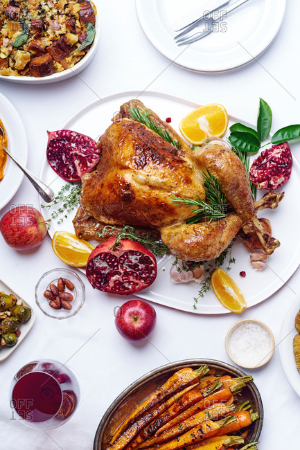 Top view of traditional thanksgiving dinner with roasted turkey and various dishes