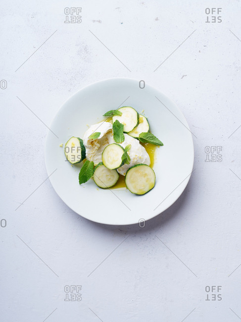 Mozzarella with sliced courgette, mint and olive oil