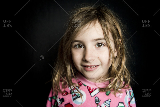 Portrait of a young girl wearing pink winter pajamas