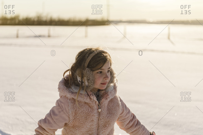 Little girl ice-skating on a frozen lake