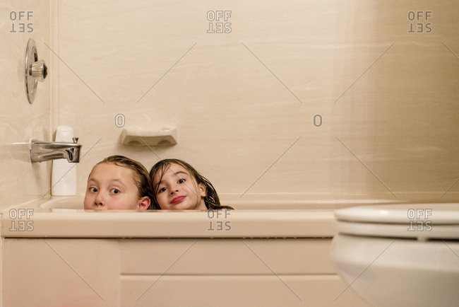 Two little girls taking a bath together