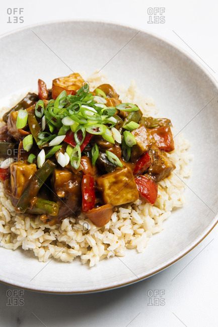 Vegan almond butter stir fry topped with sauce