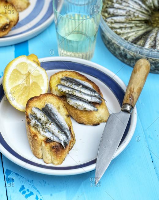Fresh anchovies on garlic toasts
