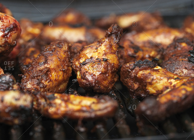 Chicken wings on grill outside