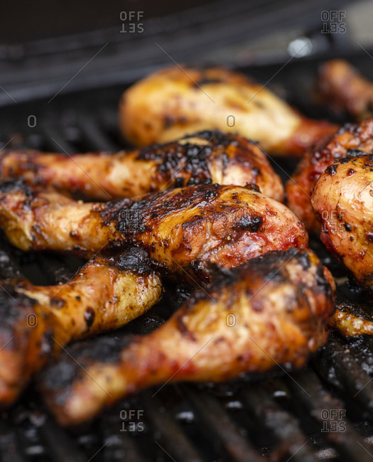 Grilling chicken outdoors on barbecue