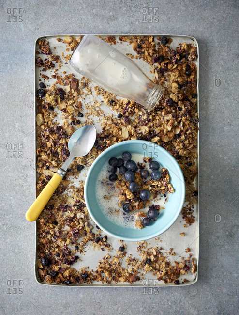 Homemade granola with a serving in a bowl