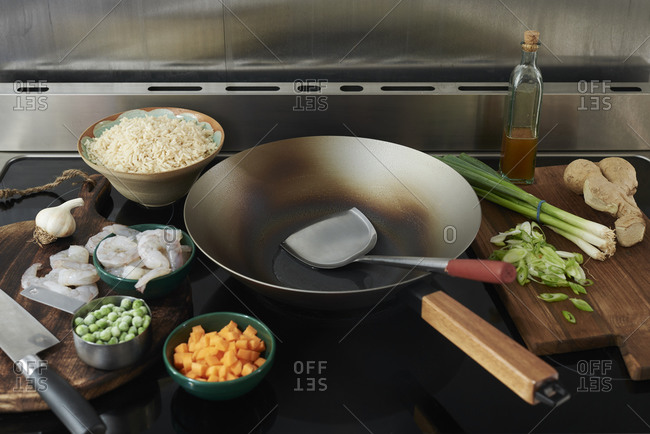 Stove with wok and ingredients for cooking