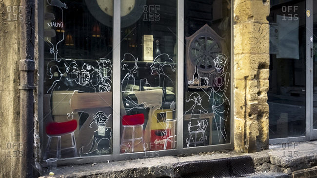 December 6, 2019: Window in front of restaurant in the Vieux Lyon district in autumn. Lyon has been a UNESCO World Heritage Site since 1998.