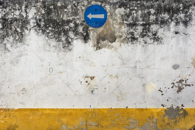 Europe, Portugal, Estremadura, Centro region, Obidos, Vila das Rainhas, City of the Queens, weathered house wall with traffic signs