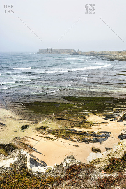 Europe, Portugal, Centro Region, Peniche, Praia do Portinho da Areia do Norte, view towards Ilheu da Papoa