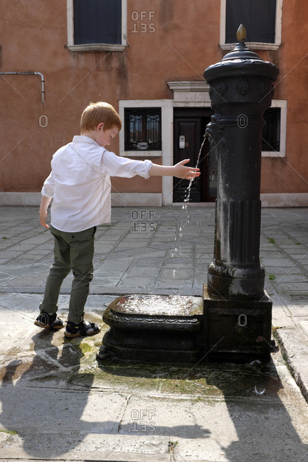 May 24, 2019: Boy at a fountain in Venice