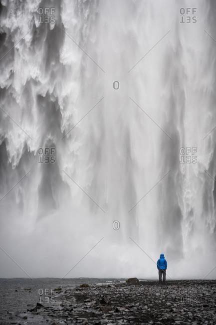 Iceland, Skogafoss waterfall, single person