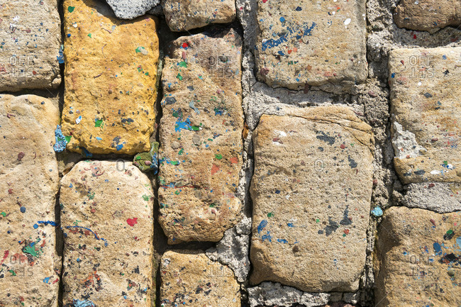 Spain, Cantabria, Castro-Urdiales, fishing port, paving stones with colored spots