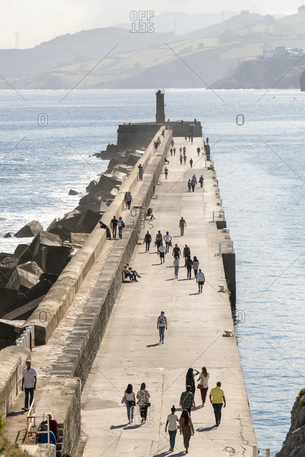 October 5, 2019: Spain, Cantabria, Castro-Urdiales, medieval port city, quay wall, promenade