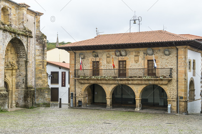October 6, 2019: Spain, north coast, Cantabria, Comillas, Plaza de la Constitucion, historic town hall