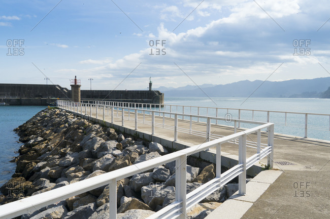 Spain, north coast, Asturias, Lastres, picturesque fishing village, harbor, breakwater, quay wall