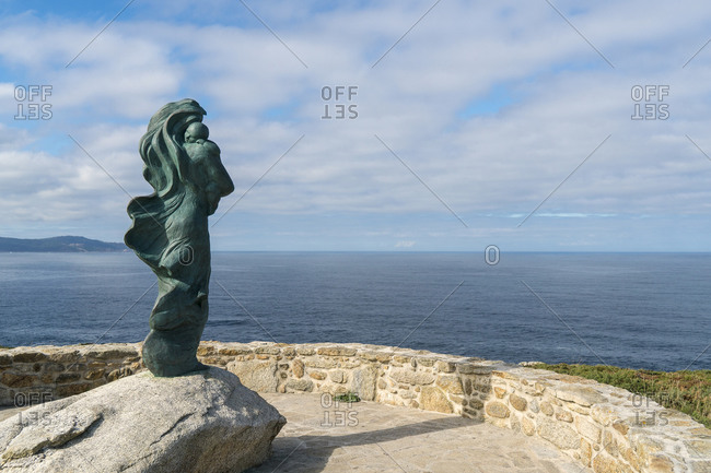 "October 11, 2019: Spain, north coast, Galicia, Costa da Morte, Faro de Laxe, sculpture ""The Waiting"""