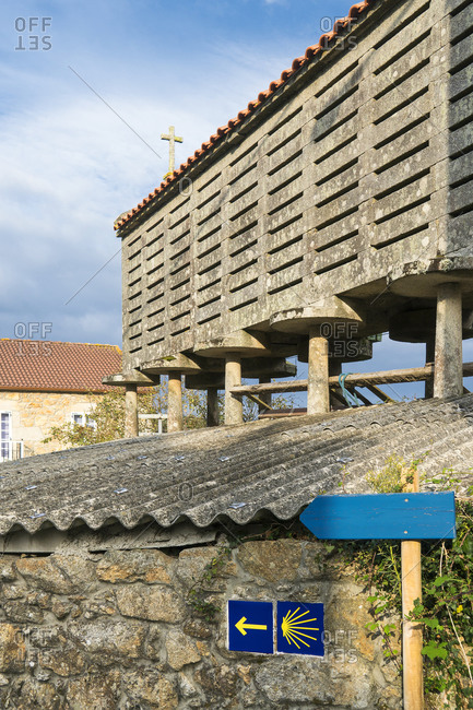 Spain, north coast, Galicia, Horreo, traditional storage building, signpost Jacobsweg