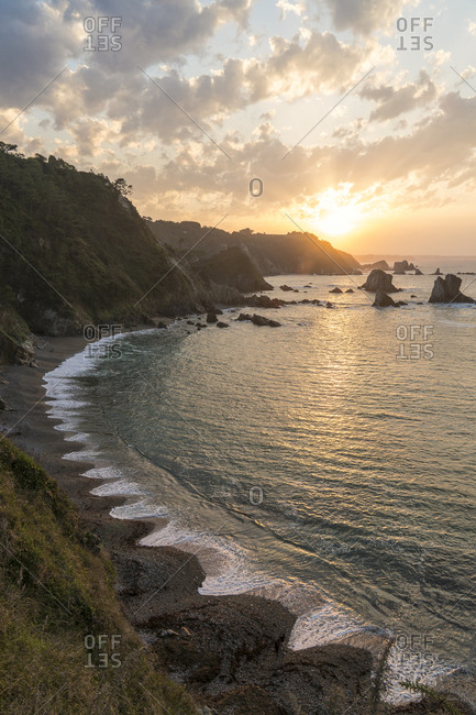 Spain, north coast, Asturias, coastline, rocks, Playa del Silencio from above, typical spike shape, sunset